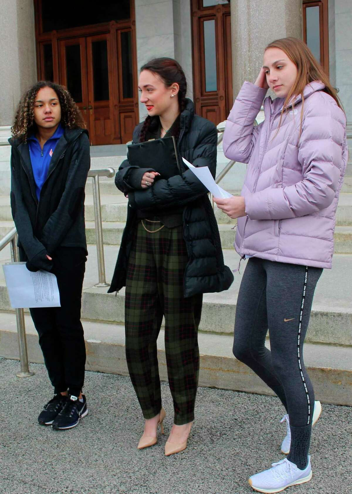 High school track athletes Alanna Smith, left, Selina Soule, center and and Chelsea Mitchell during a recent appearance at the State Capitol. They have filed a federal lawsuit to block a state policy that allows transgender athletes to compete in girls sports.