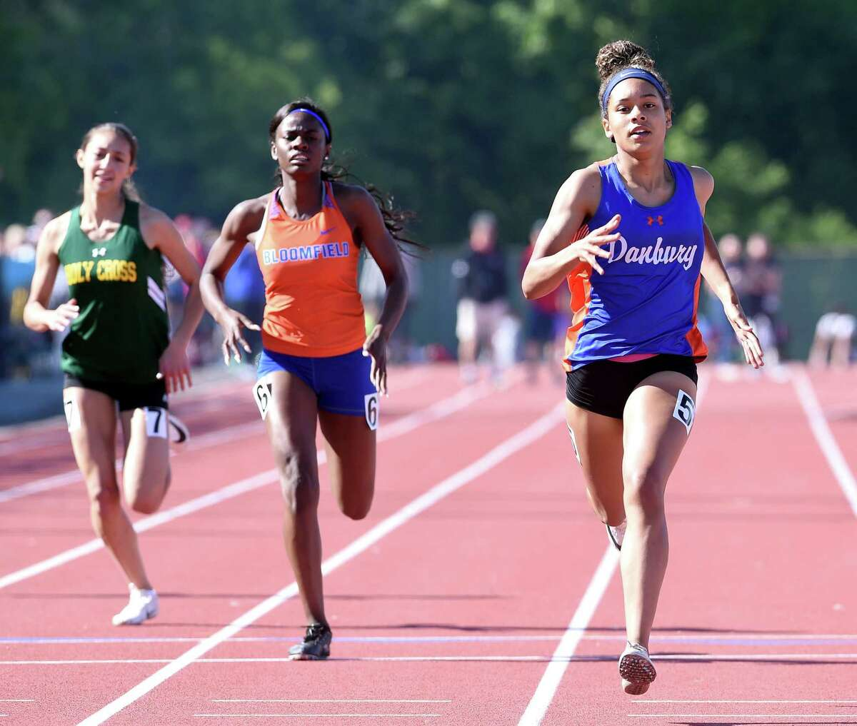 Danbury's Alanna Smith, right, wins the 400-meter dash at the State Open outdoor track championship in 2019.