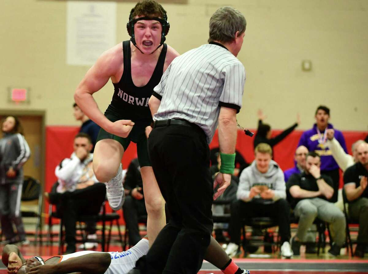 Norwalk's Brendan Gilchrist celebrates against Danbury's Tyrell Jones of Danbury in the 182 pound division at the FCIAC championship on Saturday.