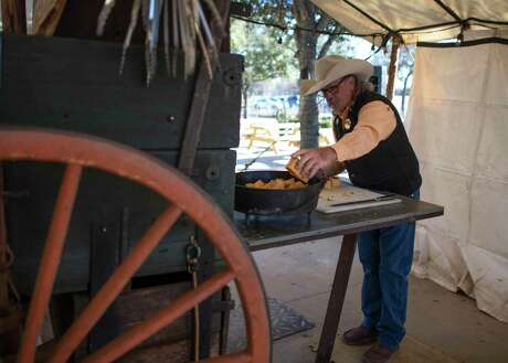From the back of his weathered chuck wagon, Buck Reams rustles up chow from the days of Texas cattle drives at the San Antonio Stock Show & Rodeo.