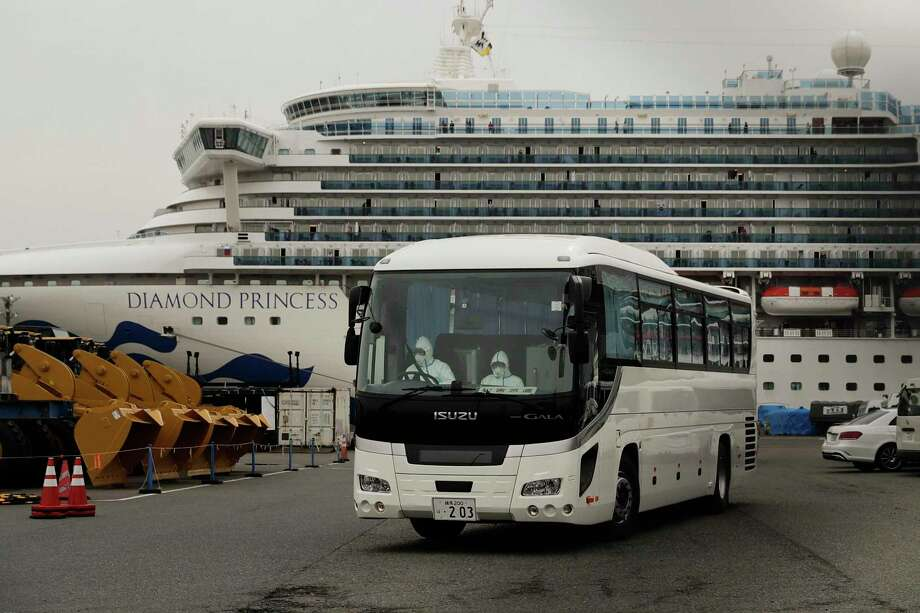 A bus leaves a port where the quarantined Diamond Princess cruise ship is docked Saturday, Feb. 15, 2020, in Yokohama, near Tokyo. A viral outbreak that began in China has infected more than 67,000 people globally. The World Health Organization has named the illness COVID-19, referring to its origin late last year and the coronavirus that causes it. (AP Photo/Jae C. Hong) Photo: Jae C. Hong, STF / Associated Press / Copyright 2019 The Associated Press. All rights reserved