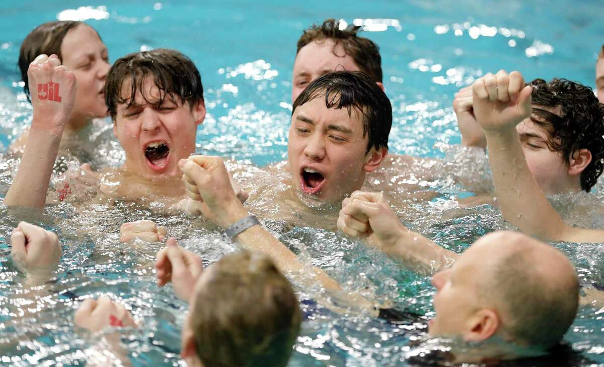 Kingwood Park swimmers celebrate after winning the 5A boys state title during the UIL State Swimming & Diving Championships at the Lee & Joe Jamail Texas Swimming Center, Saturday, Feb. 15, 2020, in Austin.