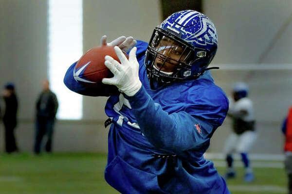 St. Louis BattleHawks defensive lineman Dewayne Hendrix, of O'Fallon, practices short-pass blocks and interceptions during drills this week at Lou Fusz Athletic Training Center in Earth City, Missouri.