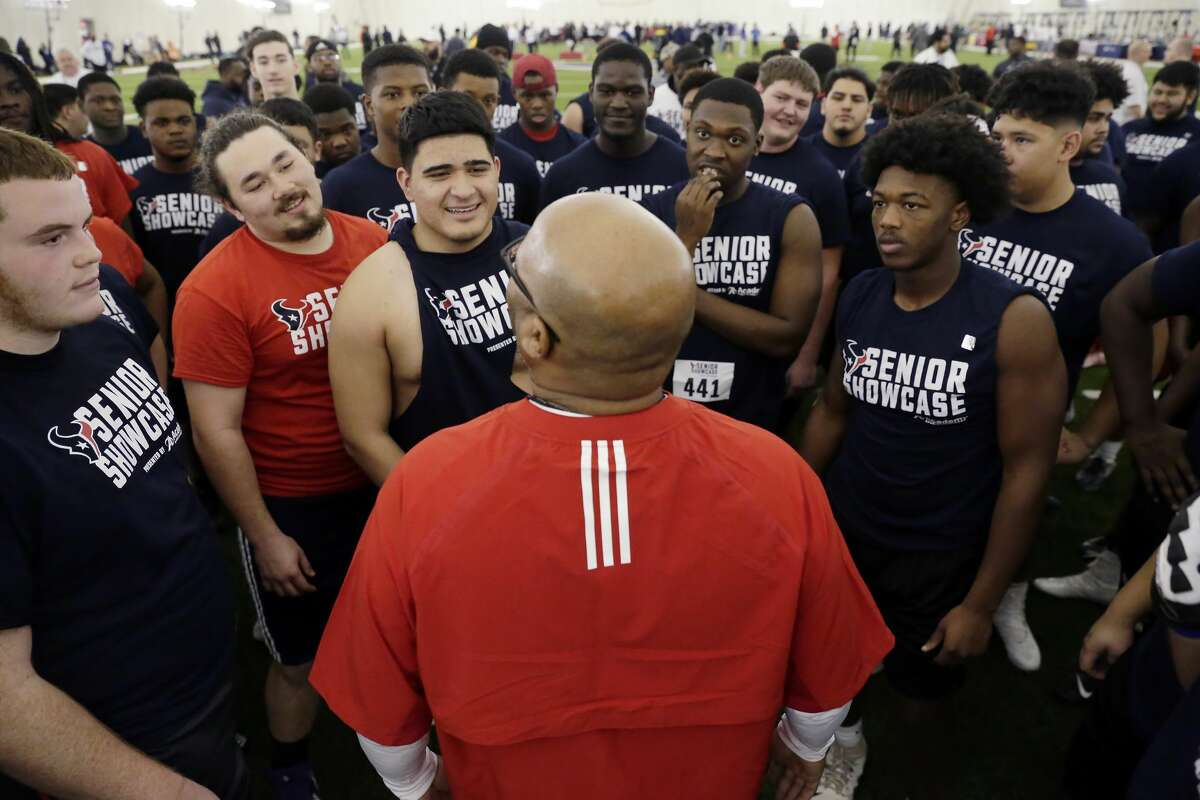 Linemen gather around a coach as they prepare for another drill during the high school football player Senior Showcase held at the Texans' Houston Methodist Training Facility Saturday, Feb. 15, 2020 in Houston, TX. Small colleges attend to see how prospective athletes perform on various position drills.
