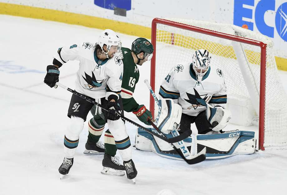 Sharks goalie Martin Jones makes a glove save on a shot by the Wild's Jason Zucker. Jones turned aside 39 shots in his first shutout of the season. Photo: Tom Olmscheid / Associated Press
