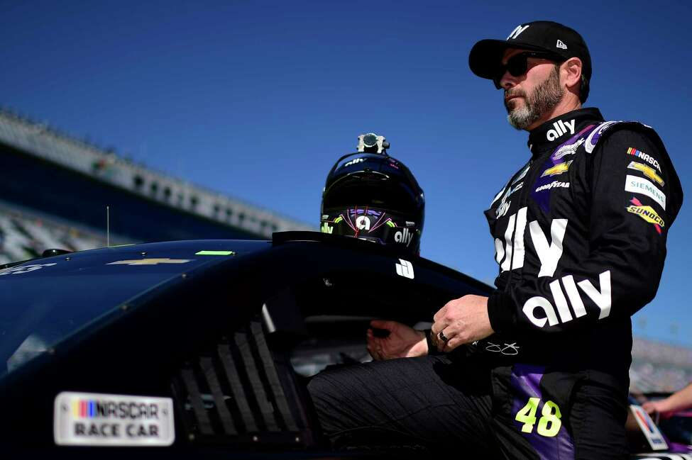 DAYTONA BEACH, FLORIDA - FEBRUARY 09: Jimmie Johnson, driver of the #48 Ally Chevrolet, climbs into his car during qualifying for the NASCAR Cup Series 62nd Annual Daytona 500 at Daytona International Speedway on February 09, 2020 in Daytona Beach, Florida. (Photo by Jared C. Tilton/Getty Images)