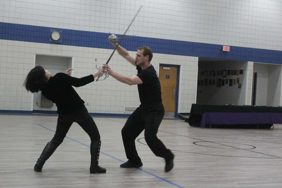 Area residents had the unique opportunity to learn skills in theatrical combat Saturday evening. As part of the Festival of the Arts, Ring of Steel Theatre and Stunt Troupe visited St. Mary's Parish Center for a performance in swordplay and stuntwork. Established in 1989, the group performs across the nation in renaissance festivals, parties, Sci/Fi and fantasy conventions, films and more. Additionally, the stunt troupe offers workshops as well as summer camp programs for individuals interested in learning choreographed combat skills. (Pioneer photos/Catherine Sweeney) Photo: (Pioneer Photos/Catherine Sweeney)