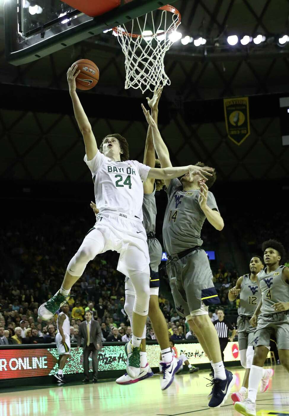 WACO, TEXAS - FEBRUARY 15: Matthew Mayer #24 of the Baylor Bears goes up for a shot against Chase Harler #14 of the West Virginia Mountaineers during the second half at Ferrell Center on February 15, 2020 in Waco, Texas. (Photo by Ronald Martinez/Getty Images)