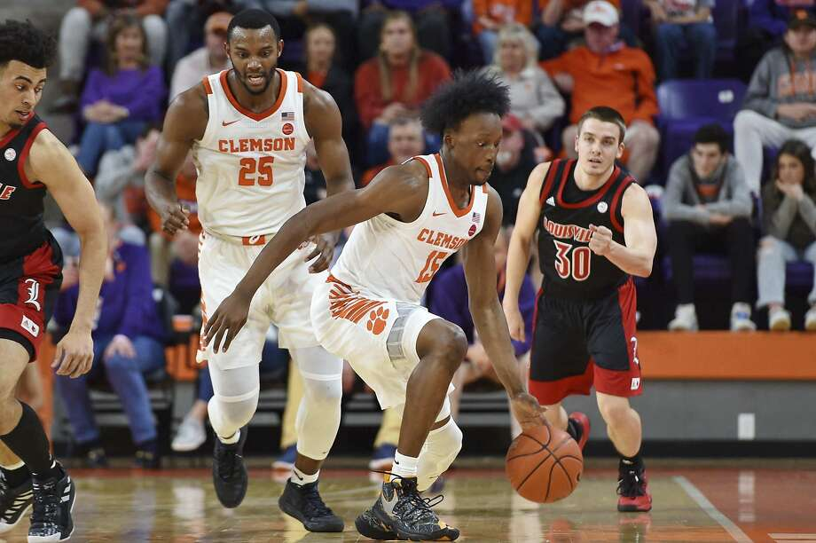 John Newman III (center) increased his aggression and made his foul shots to help lead Clemson to an upset of Louisville. Photo: Richard Shiro / Associated Press