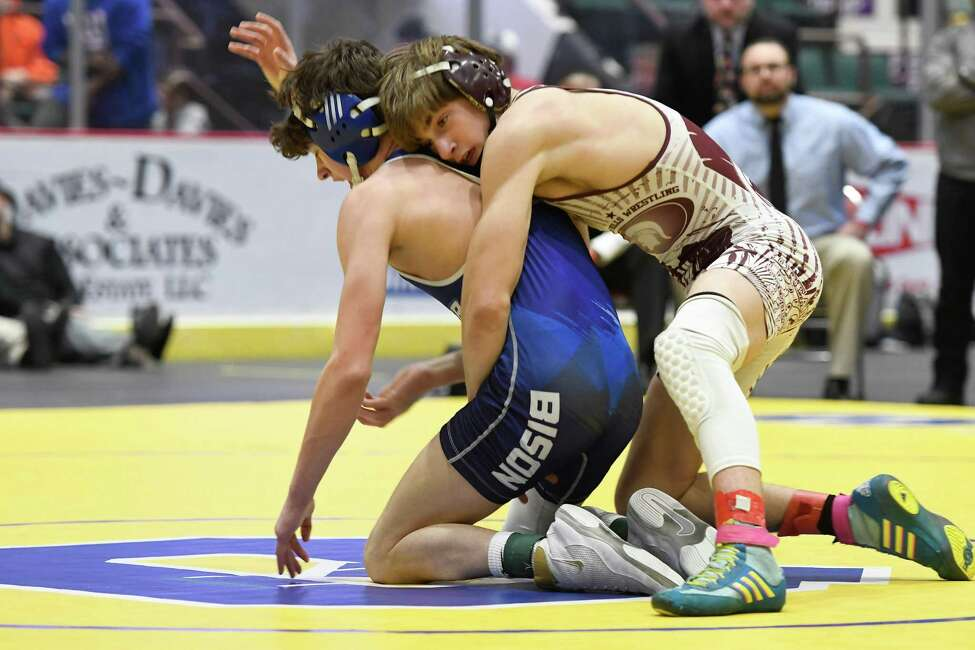 Shaker's Michael Santore wrestles Burnt Hills's Colin Carln during the division I 126-lb. weight class final of the Section II wrestling championships on Saturday, Feb. 15, 2020, at Cool Insuring Arena in Glens Falls. (Jenn March, Special to the Times Union)