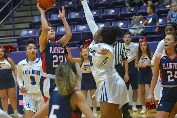 Plainview's Osen Ellis sinks the floater for an Amarillo Palo Duro defender during their District 3-5A playoff play-in game on Saturday, Feb. 15, 2020 at Dimmitt High School