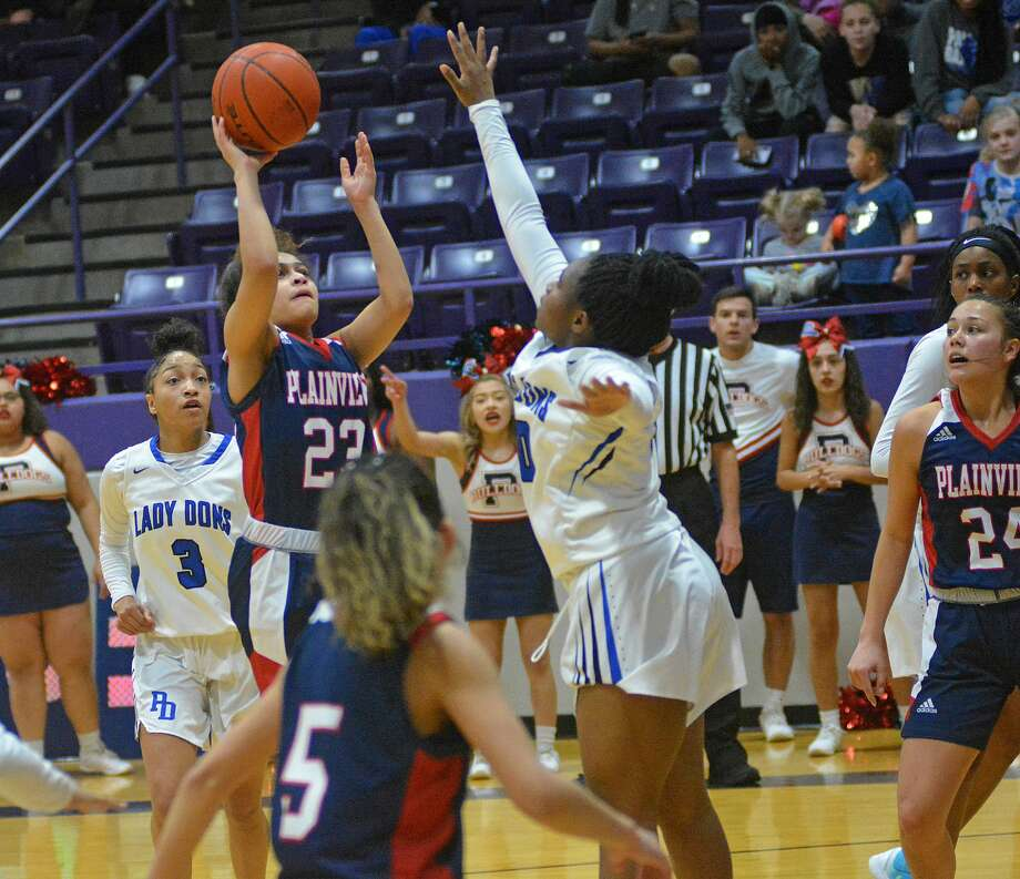Plainview's Osen Ellis sinks the floater for an Amarillo Palo Duro defender during their District 3-5A playoff play-in game on Saturday, Feb. 15, 2020 at Dimmitt High School Photo: Nathan Giese/Planview Herald
