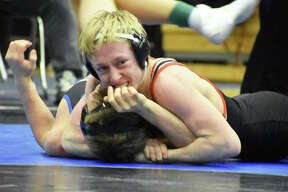 Edwardsville's Dylan Gvillo looks to the official for a pin call during his consolation semifinal match at 126 pounds in the Class 3A Quincy Sectional.
