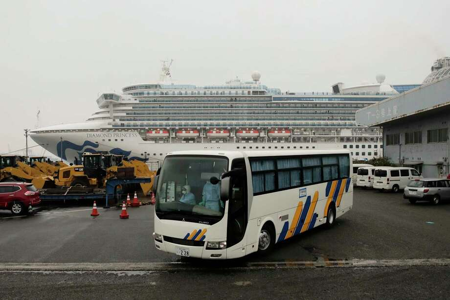 A bus leaves the quarantined Diamond Princess cruise ship at a port Sunday, Feb. 16, 2020, in Yokohama, near Tokyo. The U.S. says Americans aboard a quarantined ship will be flown back home on a chartered flight Sunday, but that they will face another two-week quarantine. Photo: Jae C. Hong, AP / Copyright 2019 The Associated Press. All rights reserved