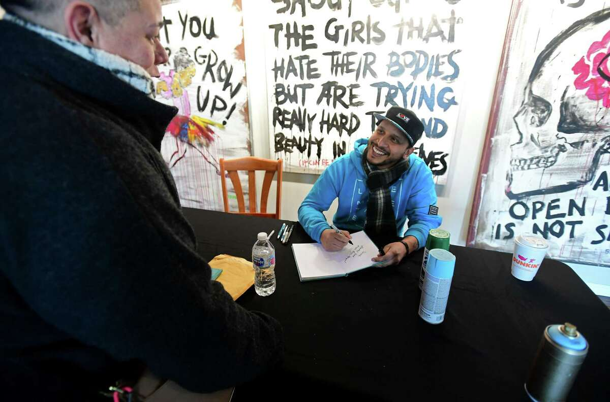Norwalk artist 5iveFingaz holds a book signing event for his new book, Love More Than Ever, Saturday, February 15, 2020, at the Mad Lab on Leonard St. in Norwalk, Conn.