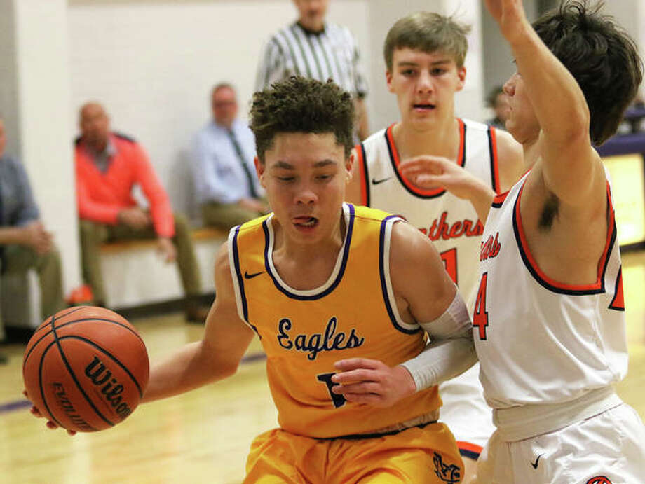 CM's Trey Hall (left) handles the basketball while Pana's Bryce Edmiston (right) defends during a Litchfield Tourney game Jan. 21. On Saturday night, Hall had 16 points and 10 rebounds in an Eagles' win over Rochester in Bethalto. Photo: Greg Shashack / The Telegraph