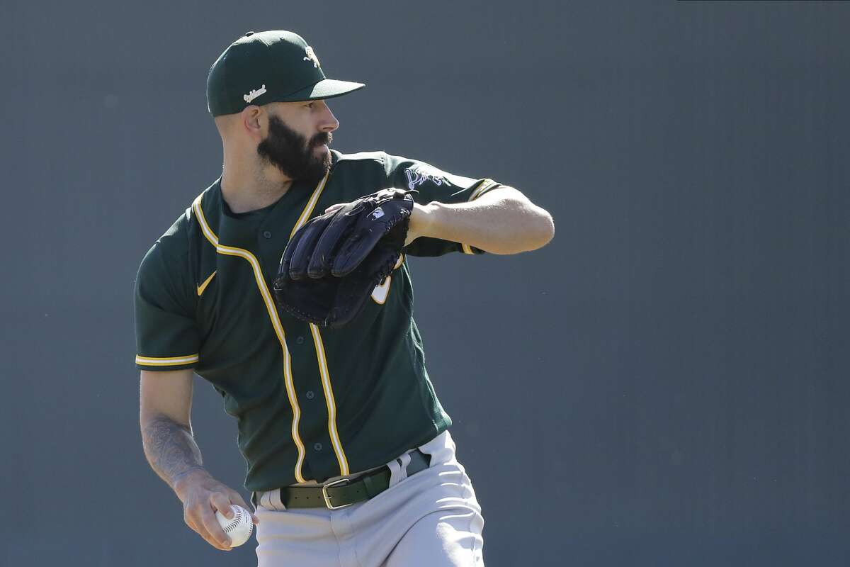 Oakland Athletics' Mike Fiers participates in a drill during spring training baseball practice, Thursday, Feb. 13, 2020, in Mesa, Ariz. (AP Photo/Darron Cummings)