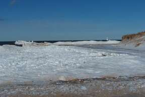 The waves were pounding the shore at First Street Beach in Manistee on Sunday morning.
