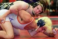 Trumbull's Jack Ryan works toward a 9-1 major decision in his FCIAC 132-pound final with Danbury's Matt Lucas.