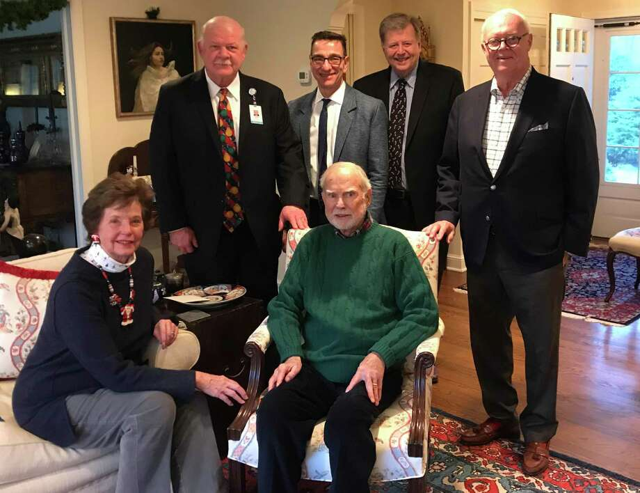 Philanthropists Mimi Kirk and Don Kirk have given a $5 million gift to Greenwich Hospital to aid its work against infectious diseases. The couple, at front, was thanked by, in back, Greenwich Hospital President and CEO Norman Roth, Chief of Infectious Diseases Dr. James Sabetta, Hospital CFO Gene Colucci and board Chair Arthur Martinez. Photo: Contributed /