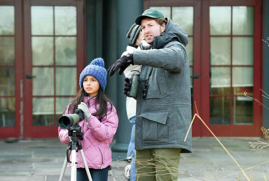 Cristina Buccieri of Port Chester, NY and Naturalist Ryan MacLean of Greenwich Audobon participate in the Great Backyard Bird Count at the Greenwich Audubon Center on Feb 15, 2020 in Greenwich, Connecticut. About a half dozen birding enthusiasts from around the Fairfield County area, including Port Chester, New York, were able to identify 14 different species of birds in a span of thirty minutes. The data collected is then uploaded to an online database and used by ornithologists to study the health of our bird populations. The group also learned how to identify and count backyard songbirds at the bird feeders while taking a brief walk outside to find birds. Photo: Matthew Brown / Hearst Connecticut Media / Stamford Advocate