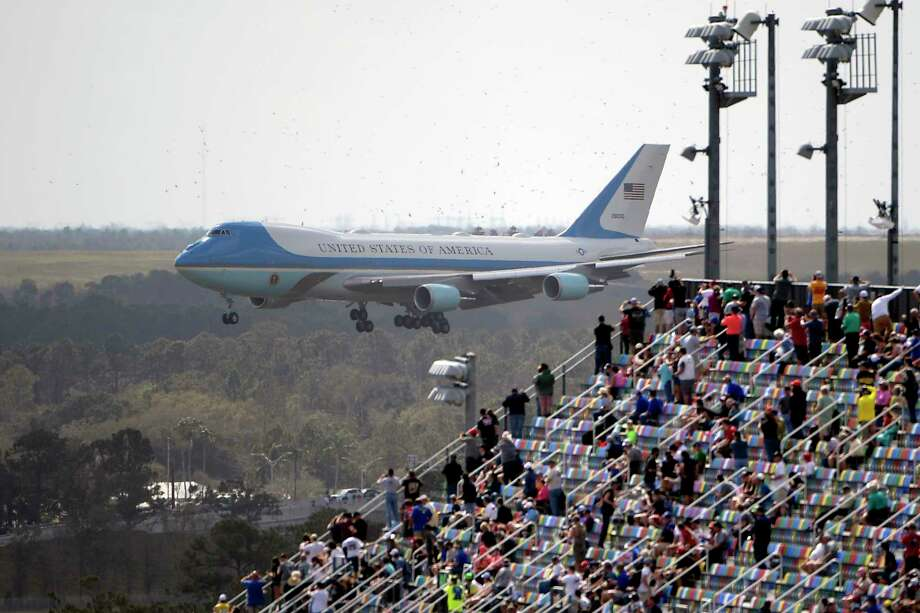 Fans watch from the grandstands as Air Force One, carrying President Donald Trump, prepares to land at Daytona International Airport before the NASCAR Daytona 500 auto race at Daytona International Speedway, Sunday, Feb. 16, 2020, in Daytona Beach, Fla. Photo: Phelan M. Ebenhack, AP / Copyright 2020 The Associated Press. All rights reserved