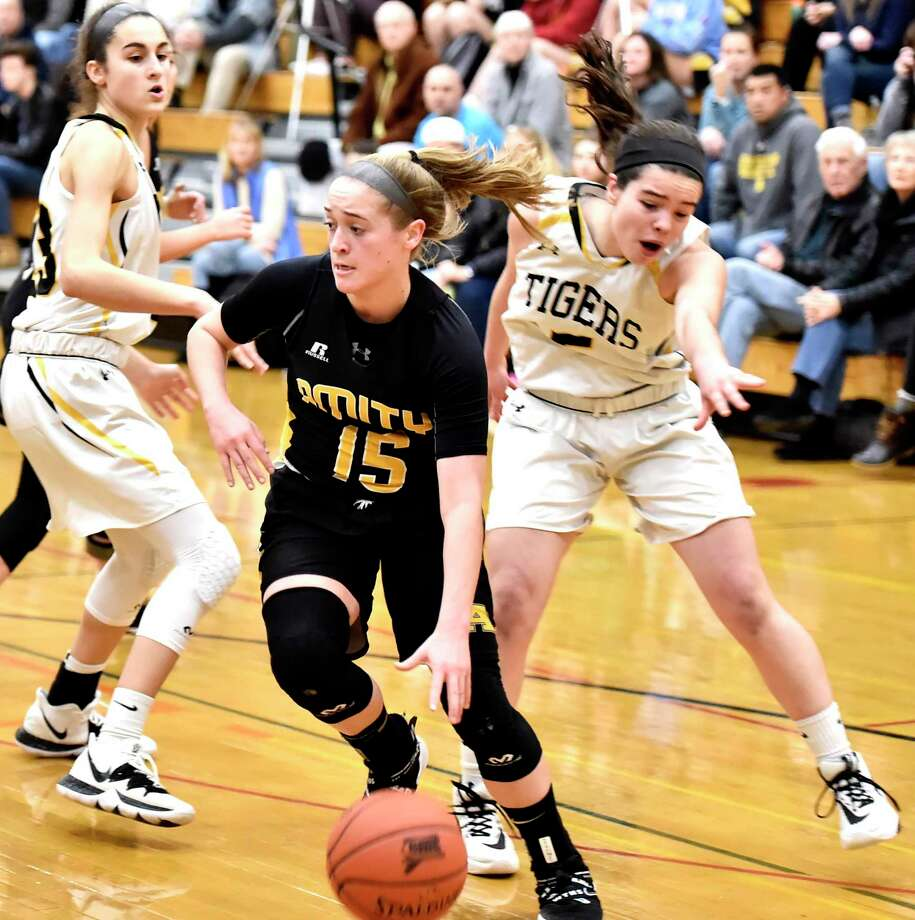Madison, Connecticut -Wednesday, January 10, 2020: Jillian Martin of Amity H.S. drives to the basket against Daniel Hand H.S. during the first quarter of girls basketball Friday evening at Daniel Hand H.S. Photo: Peter Hvizdak / Hearst Connecticut Media / New Haven Register