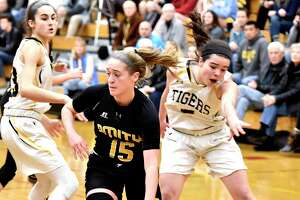 Madison, Connecticut -Wednesday, January 10, 2020: Jillian Martin of Amity H.S. drives to the basket against Daniel Hand H.S. during the first quarter of girls basketball Friday evening at Daniel Hand H.S.
