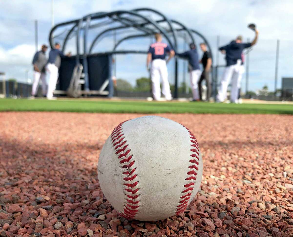 A baseball sits on the warning track during catcher's batting practice during the Houston Astros spring training workouts at the Fitteam Ballpark of The Palm Beaches, in West Palm Beach , Sunday, Feb. 16, 2020.