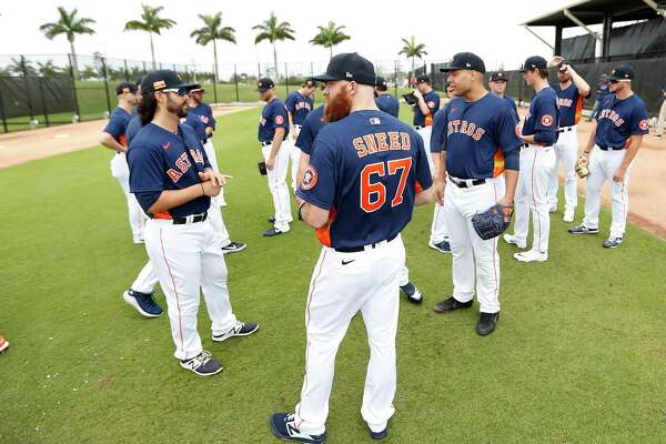 Houston Astros pitcher Cy Sneed (67) and the other pitchers wait for pitching coach Brent Strom's meeting during the Houston Astros spring training workouts at the Fitteam Ballpark of The Palm Beaches, in West Palm Beach , Sunday, Feb. 16, 2020.