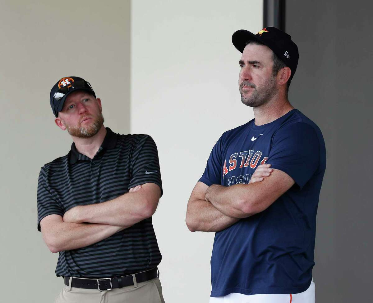 Houston Astros General Manager James Click talks with Justin Verlander during the Houston Astros spring training workouts at the Fitteam Ballpark of The Palm Beaches, in West Palm Beach , Sunday, Feb. 16, 2020.