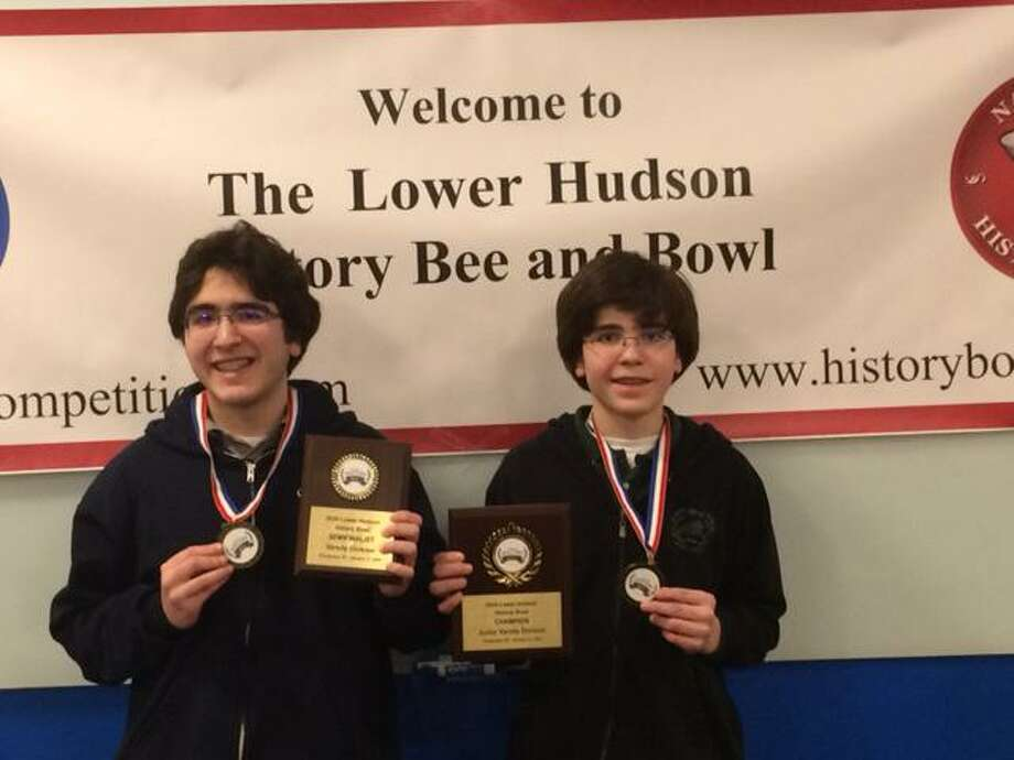 Wilton High School students Alexander, left, and Lukas Koutsoukos show off the medals they won at the Lower Hudson History Bee & Bowl competition on Jan. 11. Photo: Contributed Photo / / Wilton Bulletin Contributed