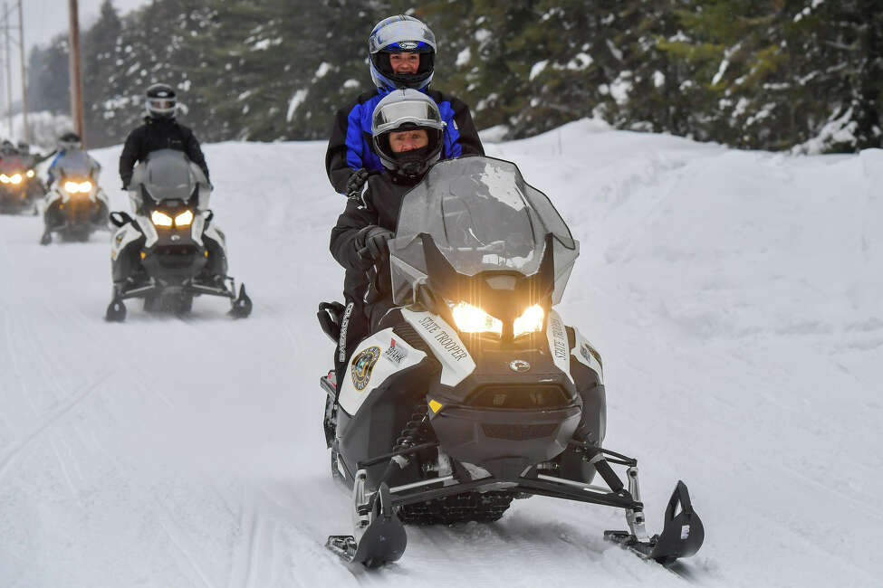 After announcing a free snowmobiling weekend on Sunday, Feb. 16, 2020, Gov. Andrew M. Cuomo went snowboarding with his daughters in Saranac Lake.