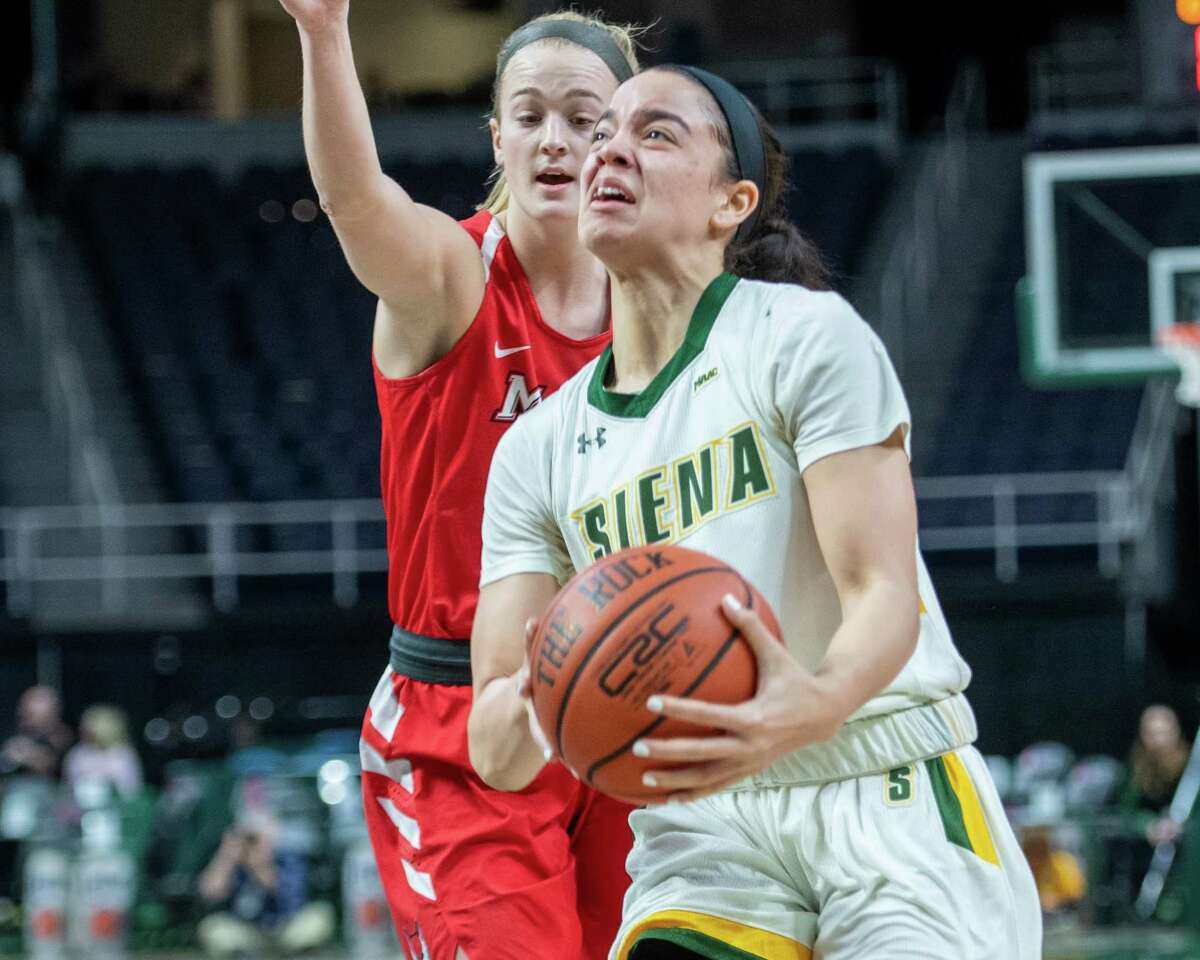 Siena College junior DeAnna Winston drives to the basket in front of Marist College senior Grace Vander Weide during a Metro Atlantic Athletic Conference game at the Times Union Center in Albany, NY on Sunday, Feb. 16, 2020 (Jim Franco/Special to the Times Union.)