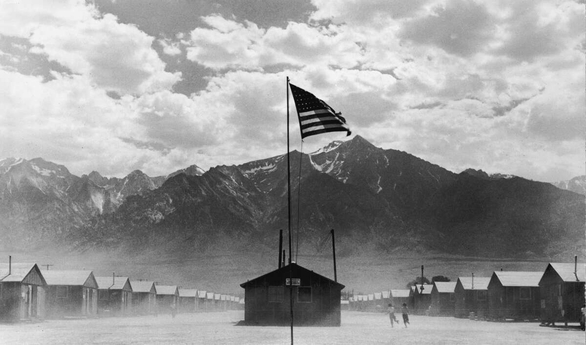 July 1942: A U.S. flag flies at the Manzanar internment camp, which is surrounded by mountains in Manzanar, California.