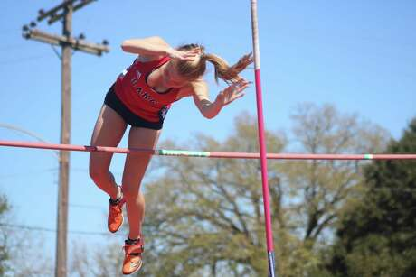 Clear Lake High School's Paige Sparks enjoys a perfect vault over the bar Friday afternoon as she coasted to the Brown Relays pole vault championship. She topped off her day with a vault of 9 feet, 6 inches.