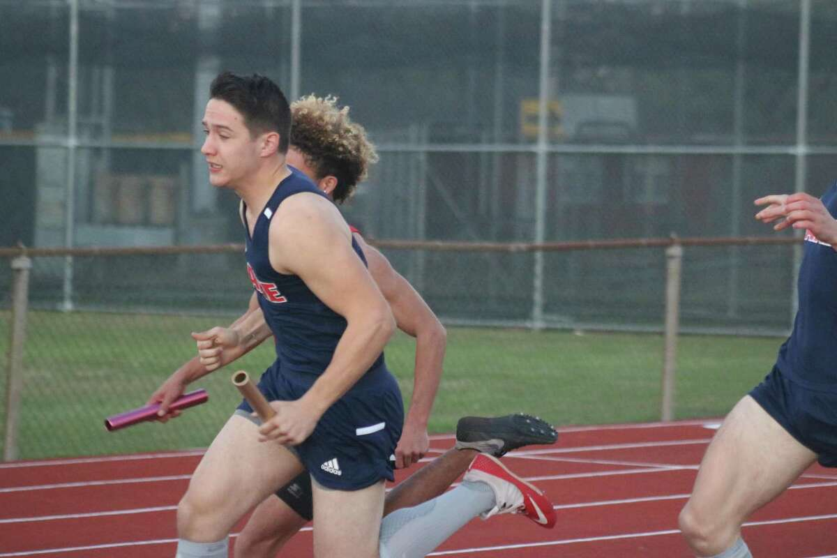 After an exchange of the baton, a Clear Lake runner heads for the home stretch during Friday's Brown Relays in Pasadena.