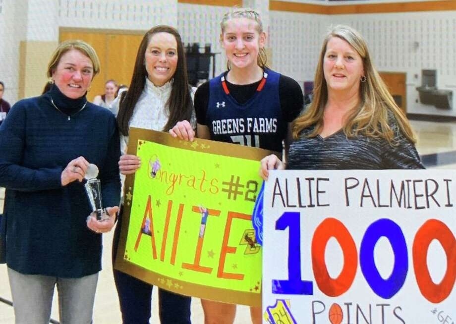 Allie Palmieri is flanked by GFA Director of Athletics Tauni Butterfield, girls' varsity basketball coach Jen Harris and her mom Wendy Palmieri after scoring her 1,000th career point. Photo: Contributed Photo / Greens Farms Academy Athletics / Trumbull Times