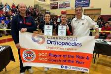 Connecticut Orthopaedics Urgent Care/SCC Cheerleader of the Year Trista Oddo from Shelton and Branford's Jade Smith, the SCC Coaches Merit Award winner, are flanked by SCC Commissioner Al Carbone and Shelton Athletic Director John Niski at the SCC cheerleading championship.