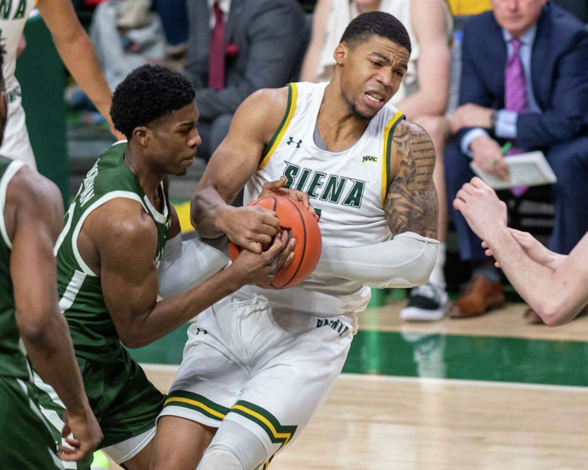 Siena College forward Elijah Burns fights for a loose ball with Manhattan sophomore Elijah Buchanan during a Metro Atlantic Athletic Conference game at the Times Union Center in Albany, NY on Sunday, Feb. 16, 2020 (Jim Franco/Special to the Times Union.)