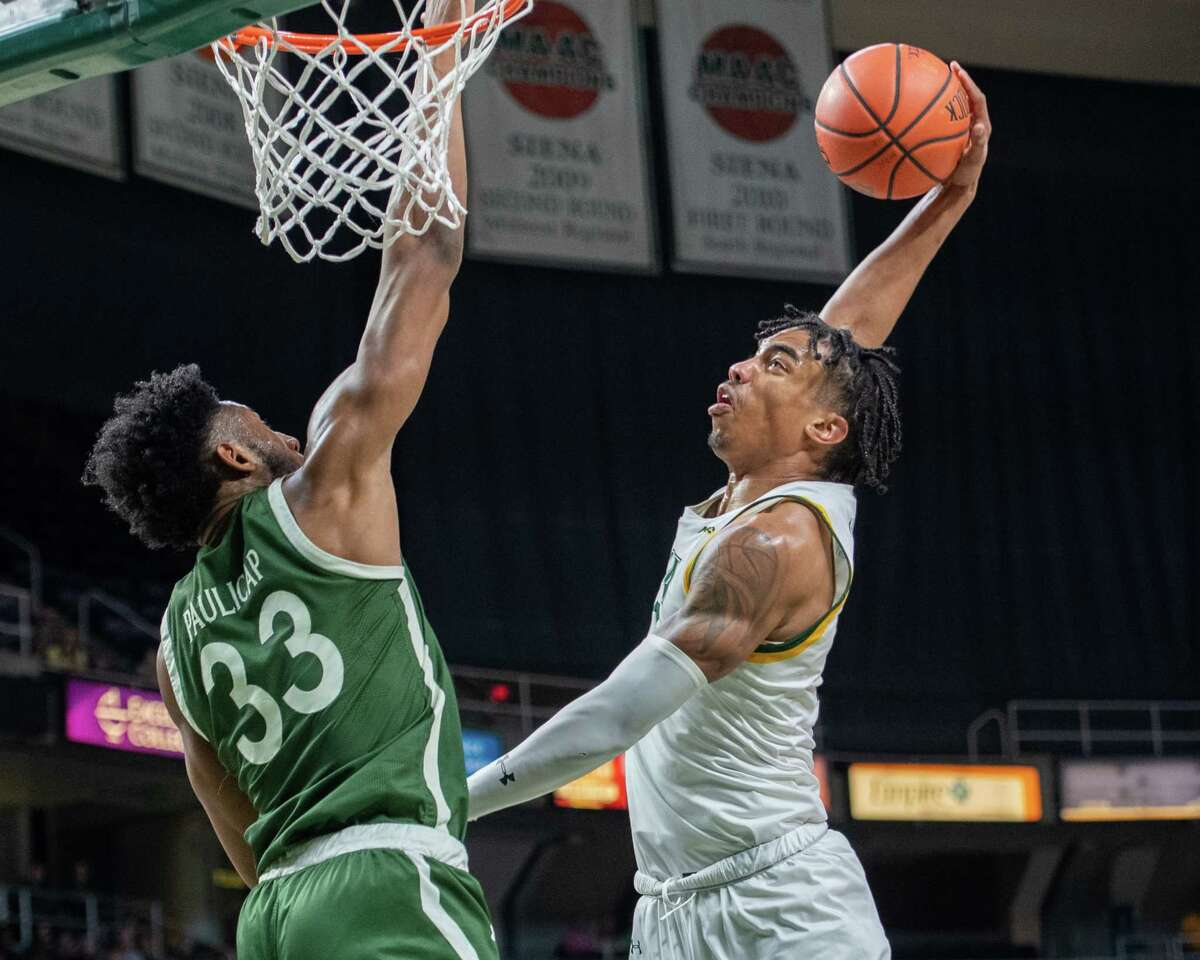Siena College junior Manny Camper goes for a dunk in front of Manhattan senior Pauly Paulicap during a Metro Atlantic Athletic Conference game at the Times Union Center in Albany, NY on Sunday, Feb. 16, 2020 (Jim Franco/Special to the Times Union.)