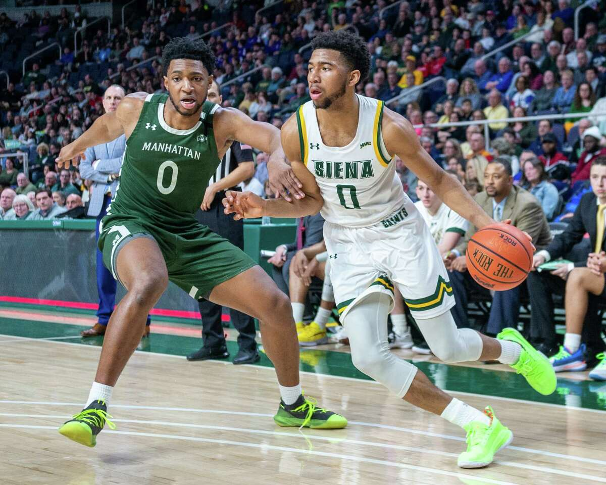 Siena College sophomore Don Carey dribbles by Manhattan sophomore Warren Williams during a Metro Atlantic Athletic Conference game at the Times Union Center in Albany, NY on Sunday, Feb. 16, 2020 (Jim Franco/Special to the Times Union.)