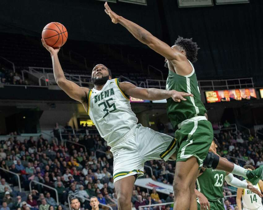 Siena College senior Sammy Friday IV takes a shot in front of Manhattan senior Pauly Paulicap during a Metro Atlantic Athletic Conference game at the Times Union Center in Albany, NY on Sunday, Feb. 16, 2020 (Jim Franco/Special to the Times Union.)