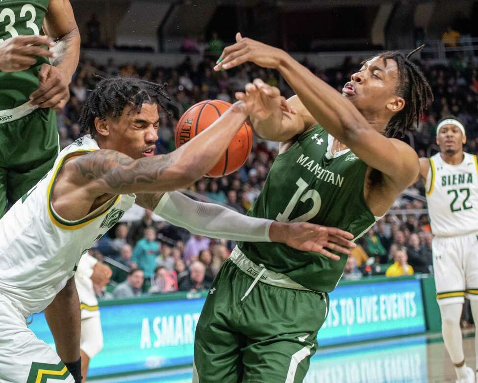 Siena College junior Manny Camper battles for a loose ball with Manhattan sophomore Christian Hinckson during a Metro Atlantic Athletic Conference game at the Times Union Center in Albany, NY on Sunday, Feb. 16, 2020 (Jim Franco/Special to the Times Union.)
