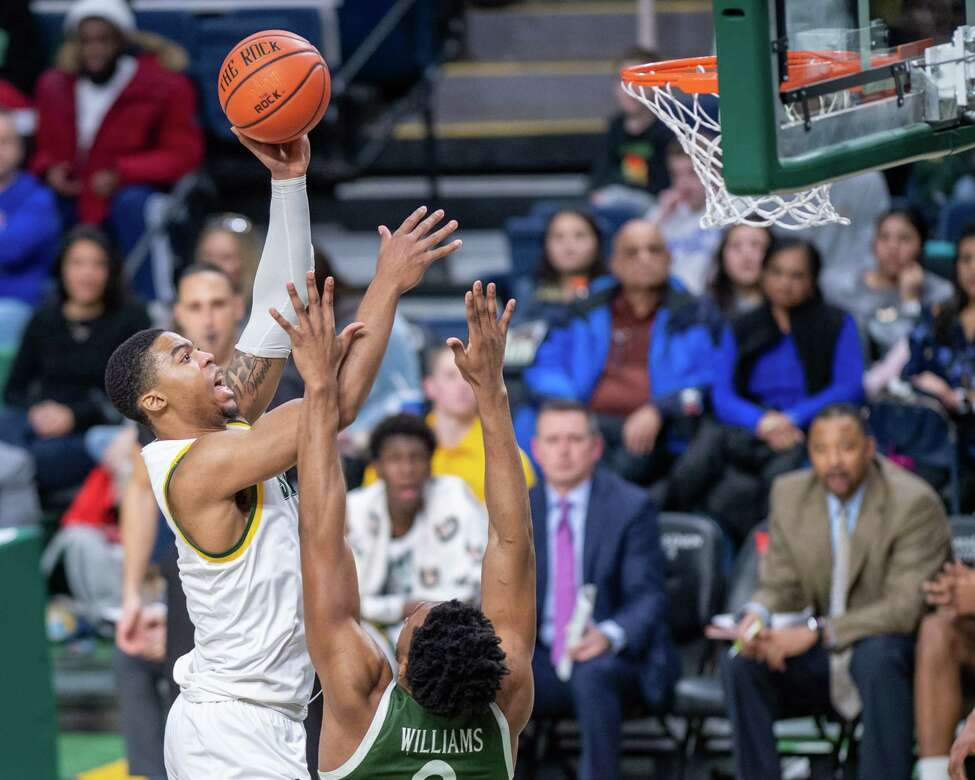 Siena College forward Elijah Burns goes over Manhattan sophomore Warren Williams during a Metro Atlantic Athletic Conference game at the Times Union Center in Albany, NY on Sunday, Feb. 16, 2020 (Jim Franco/Special to the Times Union.)