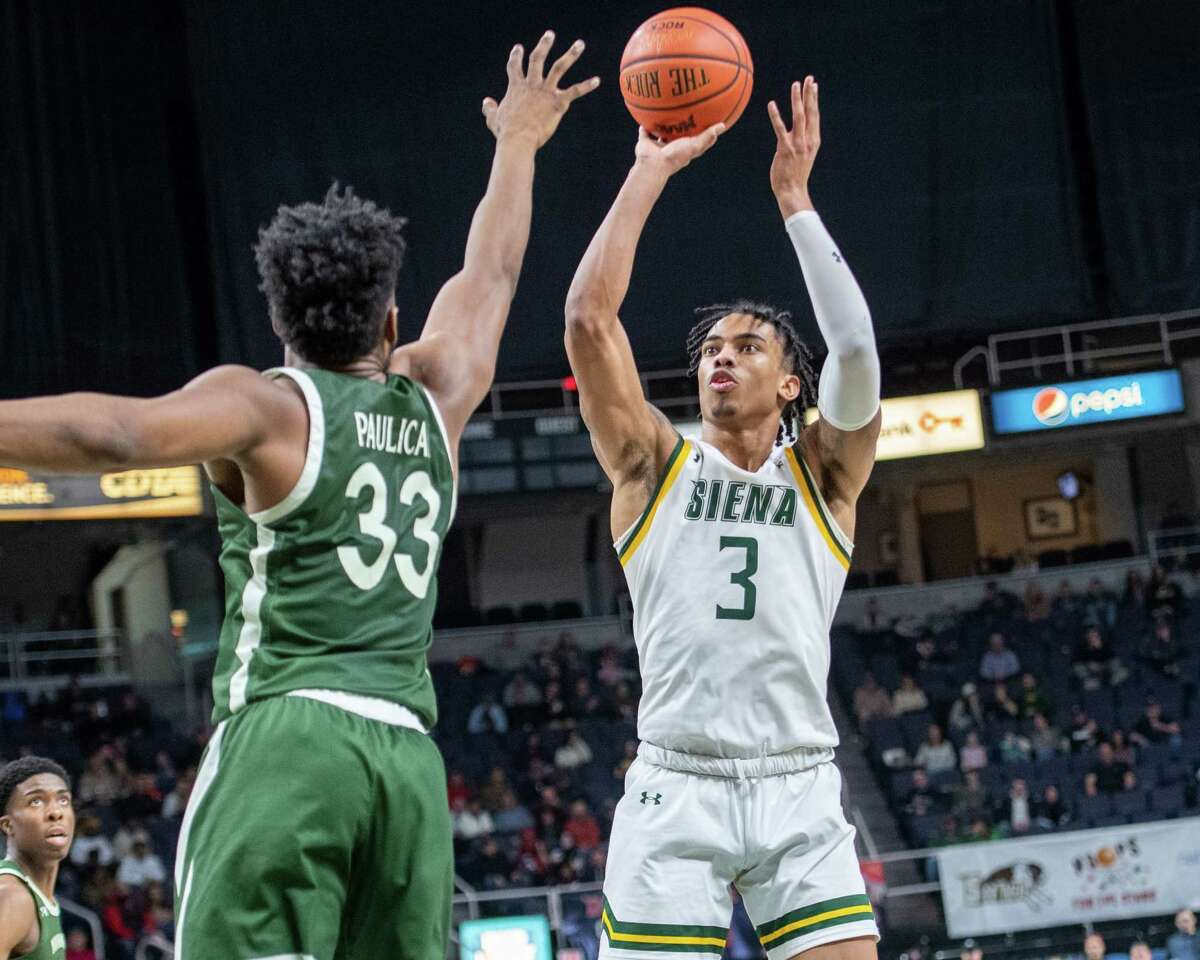 Siena College junior Manny Camper takes a jumper over Manhattan senior Pauly Paulicap during a Metro Atlantic Athletic Conference game at the Times Union Center in Albany, NY on Sunday, Feb. 16, 2020 (Jim Franco/Special to the Times Union.)