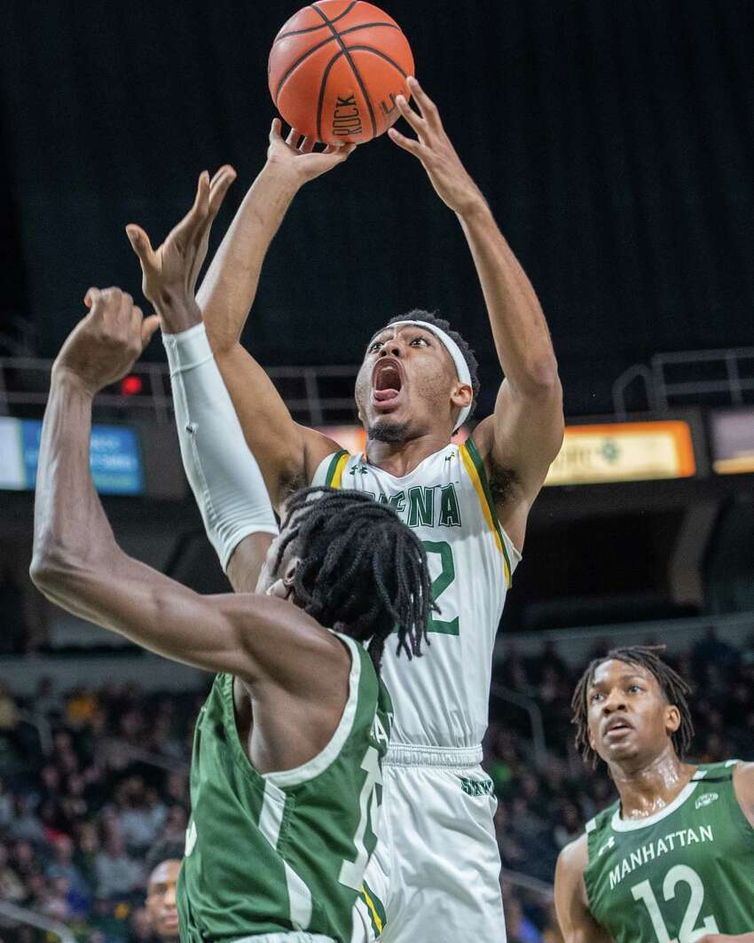 Siena College junior Jalen Pickett takes a jumper over Manhattan junior Michael during a Metro Atlantic Athletic Conference game at the Times Union Center in Albany, NY on Sunday, Feb. 16, 2020 (Jim Franco/Special to the Times Union.)