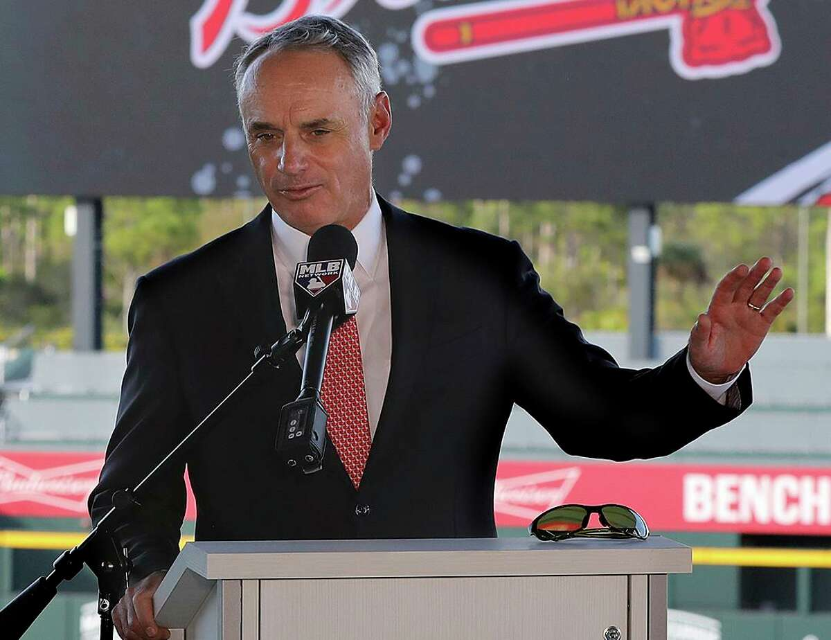 MLB commissioner Rob Manfred takes questions about the Astros during a Sunday news conference at the Atlanta Braves' spring training facility in North Port, Fla.