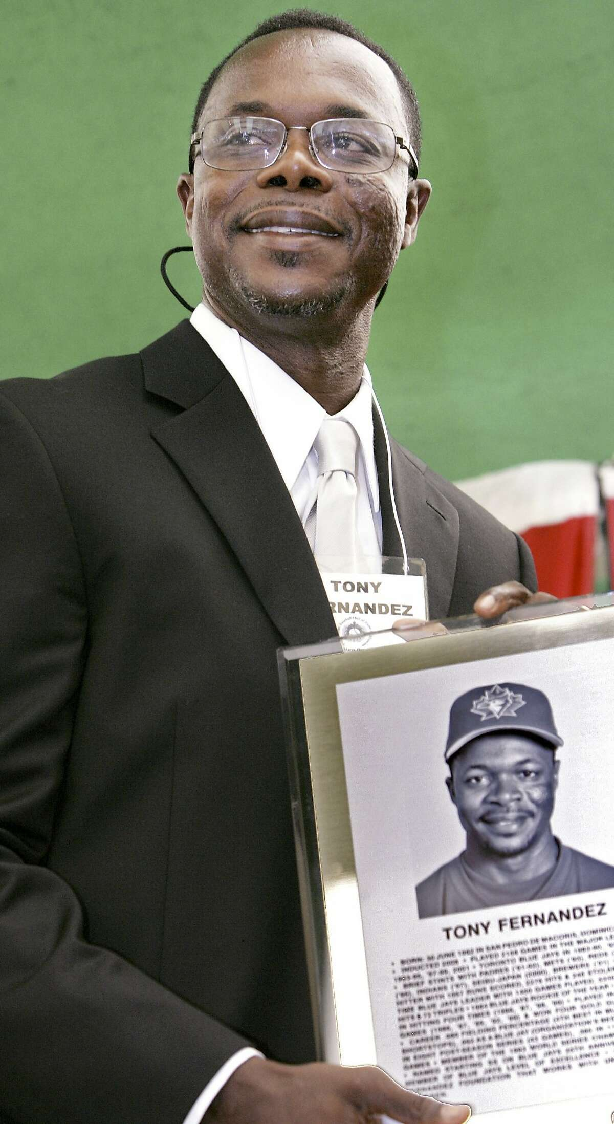 FILE - In this June 28, 2008, file photo, former Toronto Blue Jays player Tony Fernandez attends the Canadian Baseball Hall of Fame & Museum ceremony in St. Marys, Ontario. Former All-Star shortstop Fernandez remained on a life support system Sunday, Feb. 16, 2020, pending a decision by his family on how to proceed, the director of his foundation said. He had been in a medically induced coma, said Imrad Hallim, the director and co-founder of the Tony Fern�ndez Foundation. Fernandez was ill with a kidney disease for years and waiting for a transplant. (Ken Wightman, London Free Press/Canadian Press via AP, File)