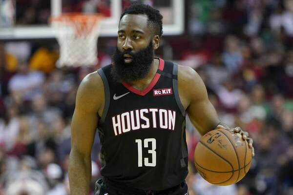 Houston Rockets' James Harden (13) brings the ball up the court against the Boston Celtics during the first half of an NBA basketball game Tuesday, Feb. 11, 2020, in Houston. (AP Photo/David J. Phillip)